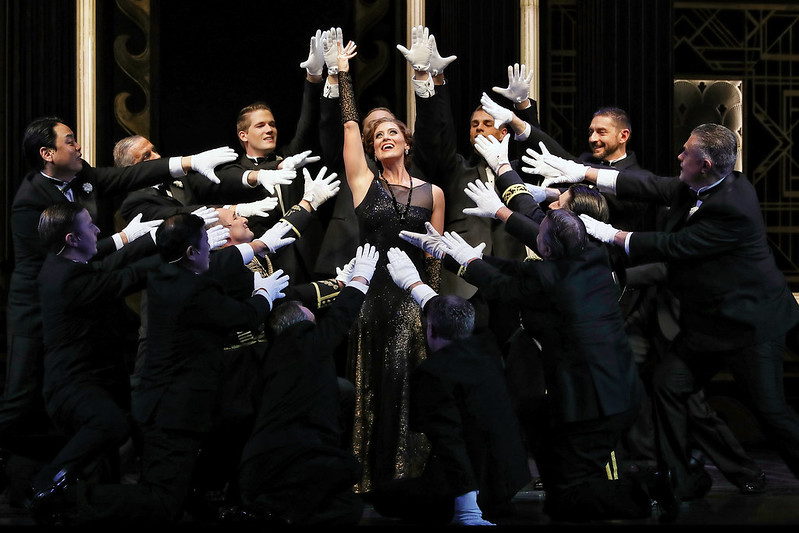 Julie Lea Goodwin with the male chorus in Opera Australia's The Merry Widow