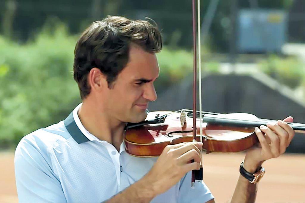 Roger Federer playing a violin